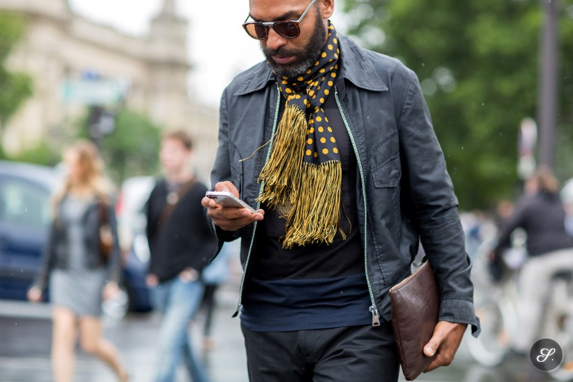 Men wearing scarf and clutch on a streetstyle photo taken during Men's season in Paris.