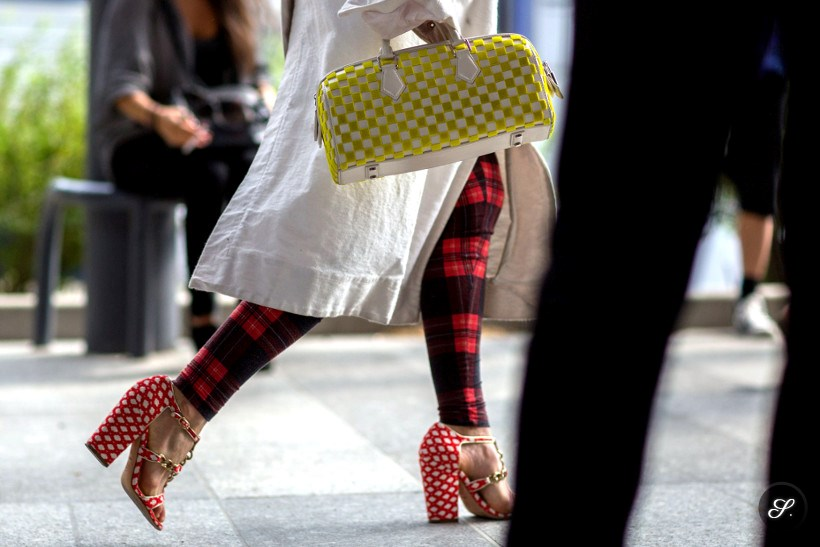 Style icon Ursina Gysi wearing bag, heels and pants with checked pattern on a street style photo taken during PFW Paris Fashion Week summer 2014.