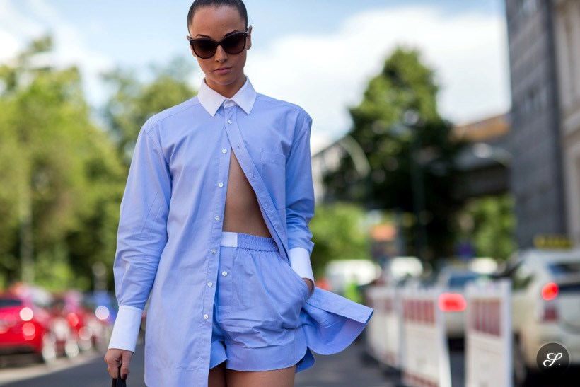 Antoaneta-Toma Petkov wearing a blue summer shirt for women and shorts on a street style photo during Premium 2014.