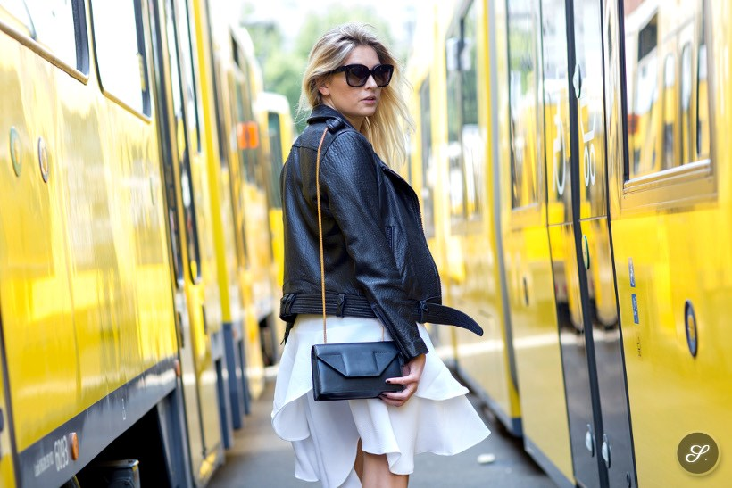 Camille Charrière wearing a Saint Laurent bag and a leather jacket from FWSS on a street style photo taken in the summery streets of Berlin.