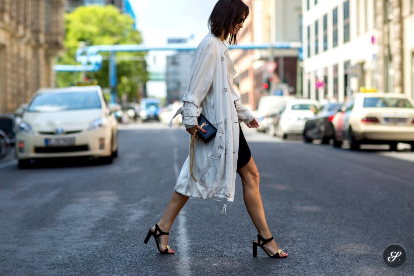 Golestaneh Mayer-Uellner wearing Acne trench coat, Celine heels, YSL bag on a street style photo taken in Berlin summer 2014.