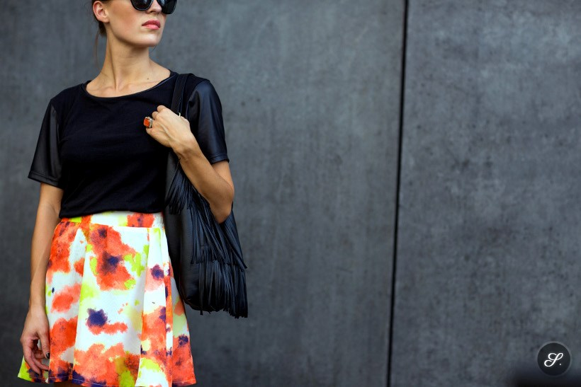 Pia Meindl wearing a colorful skirt and a black top on a street style photo taken in Berlin.