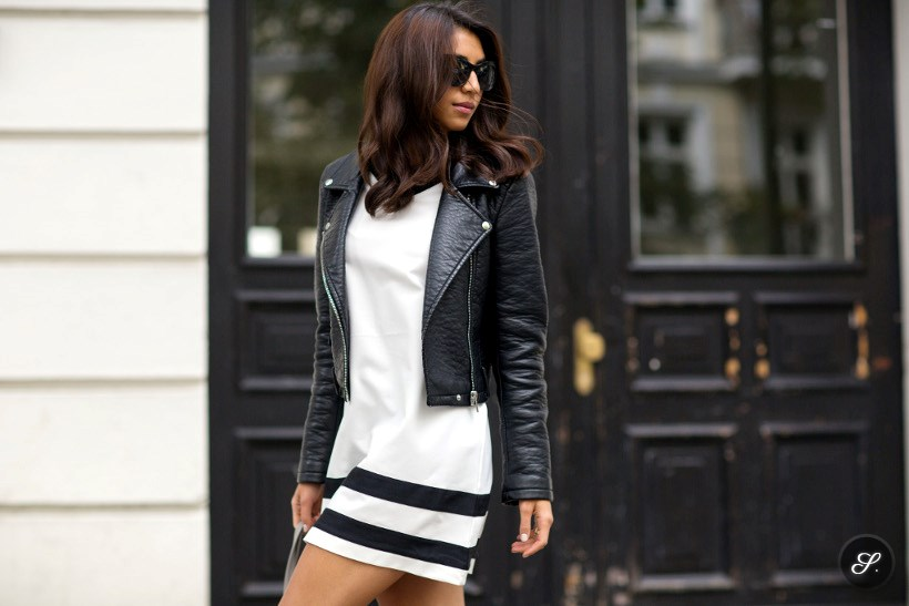 Kayla Seah wearing a dress from The Fifth a leather jacket from Zara and sunglasses from Elizabeth & James on a street style photo taken in Berlin summer 2014.