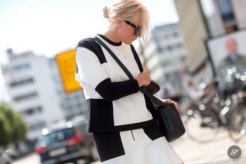 Sisse Laigaard wearing a black white patterned outfit on a street style photo taken during CPHFW Copenhagen Fashion Week summer 2014.