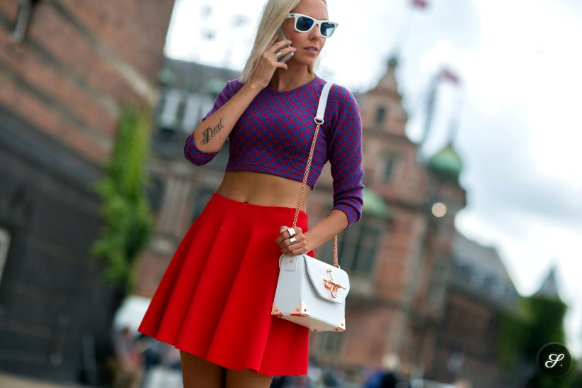 Martina Martiala wearing skirt and cropped top on a street style photo taken during CPHFW Copenhagen Fashion Week.