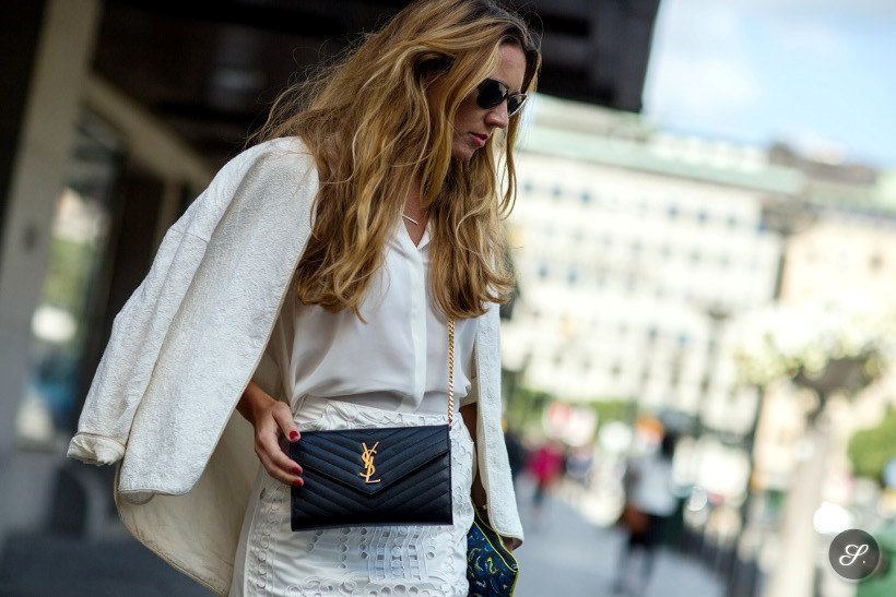 Nathalie Willebrand wearing shirt from & Other Stories, sunglasses by Céline, embossed jacket from Zara, laser cut silk lace skirt from H&M Trend, crossbag by Saint Laurent and pochette by Kenzo on a street style photo taken during Stockholm Fashion Week.