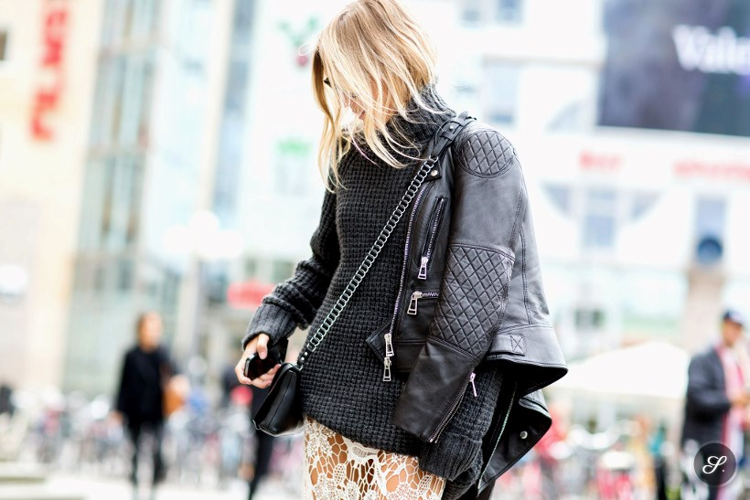 Women wearing sweater, leather jacket and lace skirt on a street style photo taken during Stockholm Fashion Week.