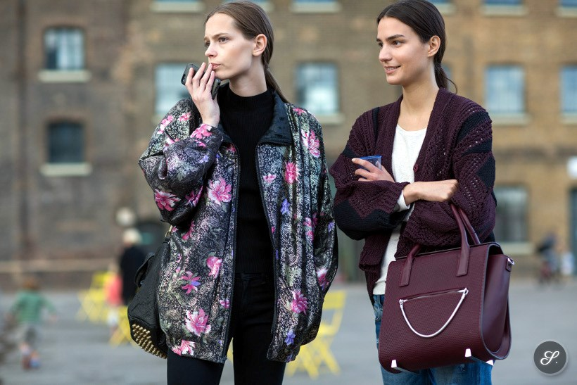 Fashion models Mina Cvetkovic Mijo Mihaljcic on a street style photo taken after Paul Smith during LFW London Fashion Week SS15.