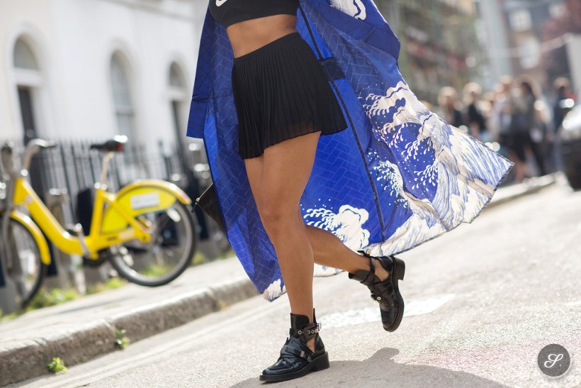 Beauty blogger Tia Ward wearing Balenciaga boots and a vintage Kimono on a street style photo taken after Topshop Unique during London Fashion Week.