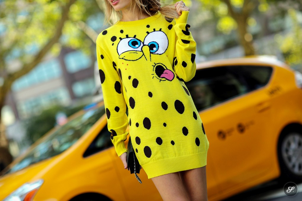 Fashion and Youtube blogger Sonya Esman wearing a Spongebob sweater during NYFW New York Fashion Week Spring Summer 2014.