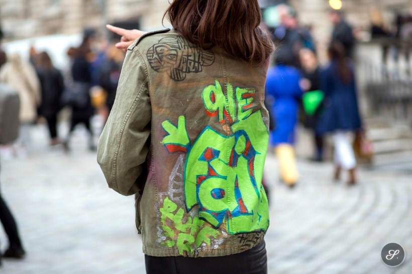 women wearing a printed jacket on a street style photo during London Fashion Week