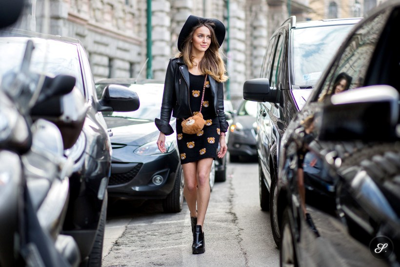 Mary Leest wearing total look Moschino on a street style photo taken during MFW.
