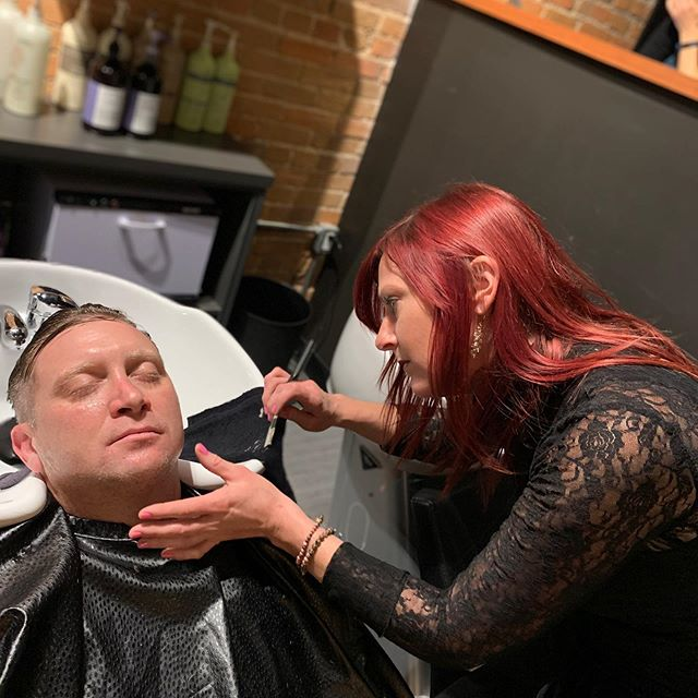 Chrissy making another guest super happy with one of our full face shaves!Call and book with a men's haircut!