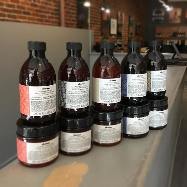 New Davines products Introducing the alchemic colour shampoos and conditioners in 6 different shades - red, copper, chocolate, tobacco, silver and golden. Each one targets a hair colour by enhancing the specific hue  it's designed for. Come check them out at our downtown location! • • • • • • • • #davines #alchemic #shampoo #ygk #conditioner #colour #ygkbeauty #kingstonhairstylist #kingstonhair #queensu