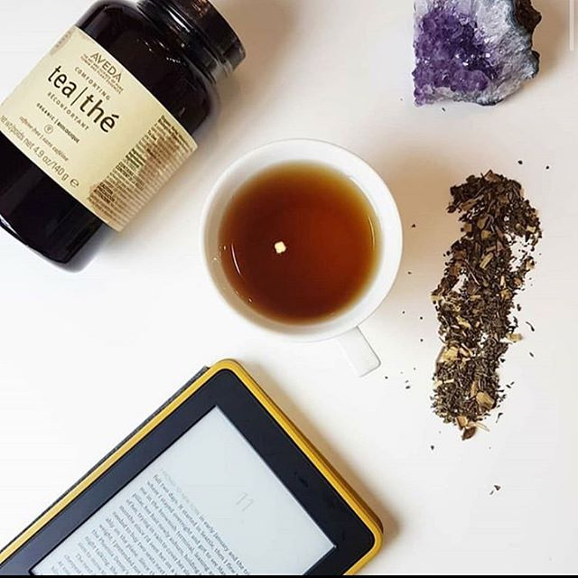 Sundays are for selfcare. You can find us this morning, wrapped in a cozy blanket, with a good read and an even better cup of tea! Aveda Comforting Tea is a soothing, certifed organic, caffeine free herbal infusion- with licorice root and peppermint.  It calms your senses, promoting a sense if wellbeing. Licorice tea helps to reduce inflammation and is good for the liver. Peppermint tea boosts your immune system while also reducing stress. Unwind with us this Sunday, try a cup today! . . . . #selfcaresunday #happysunday #relax #unwind #selfcare #avedacomfortingtea  #avedatea #tea #herbaltea #herbal #infusion #haveacuppa #comforting #calming #feelgood #calmthemind #senses #wellbeing #caffeinefree #natural #certifiedorganic #blend #stressrelief #antiinflammatory #reducestress #hotandcold #sustainablebeauty #kingston_on  #jamesbrettcoiffure #ygkaveda  @aveda @avedacanada  @jamesbrettwest  @jamesbrettdowntown