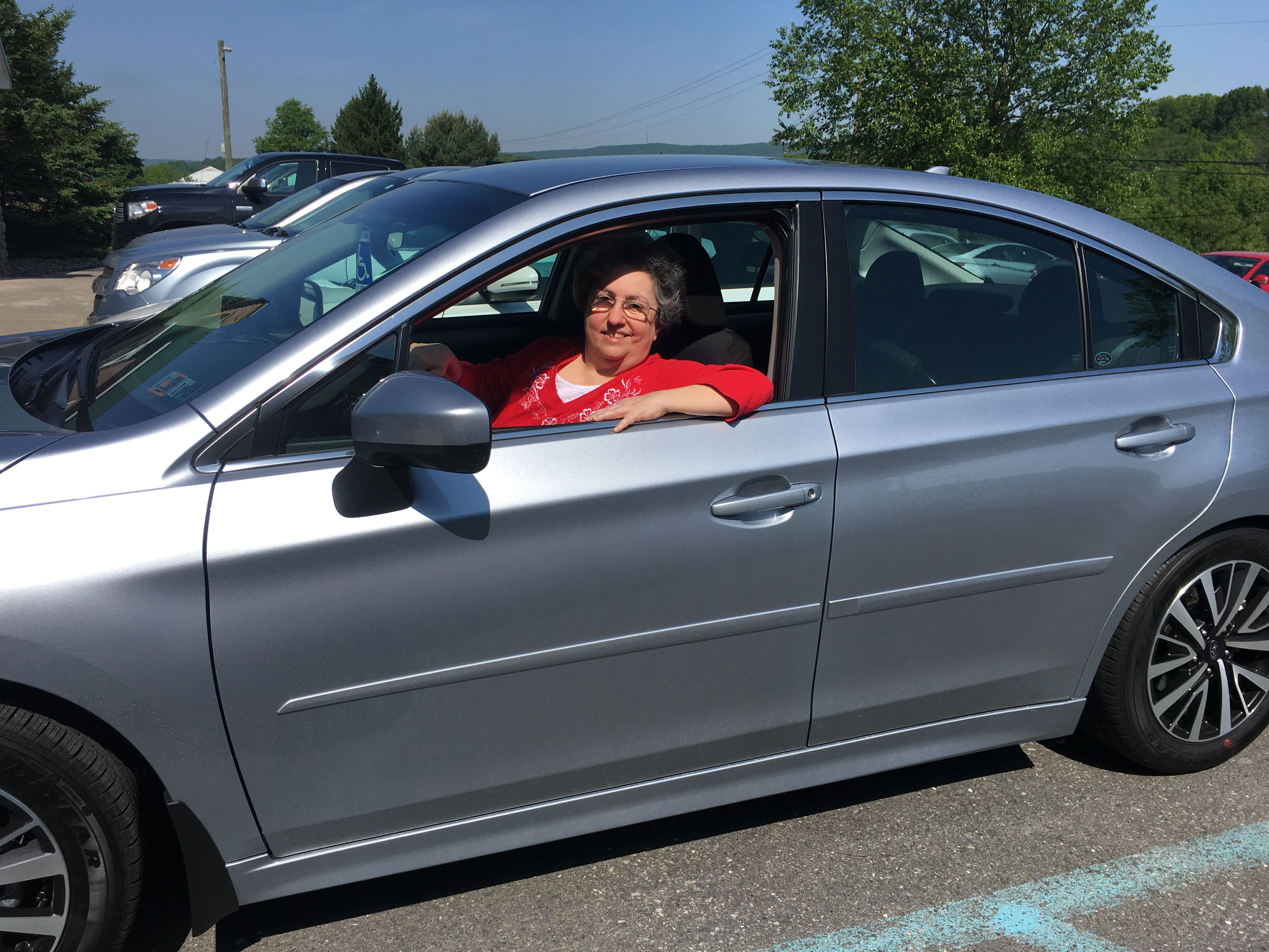 Woman returning to driving after recovering from her hand injury.
