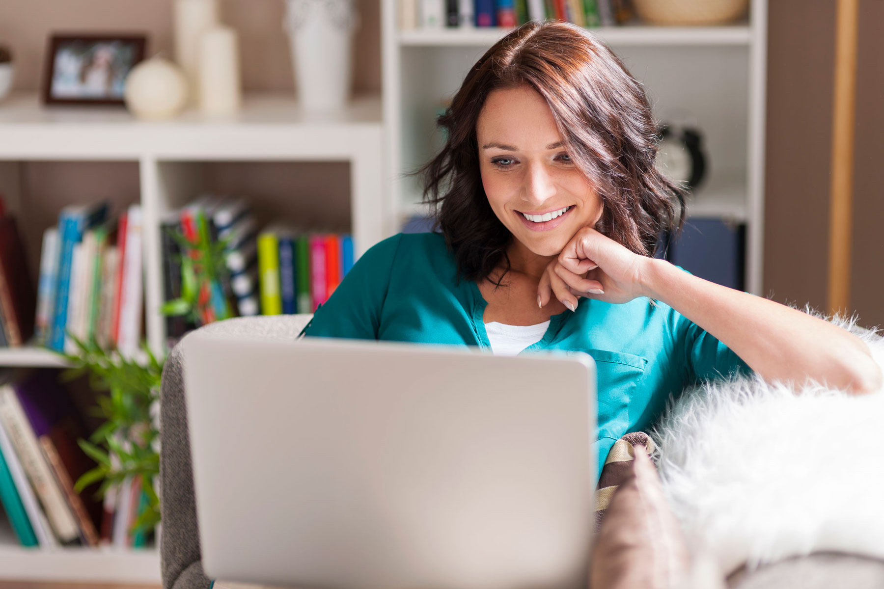 Woman at home using laptop