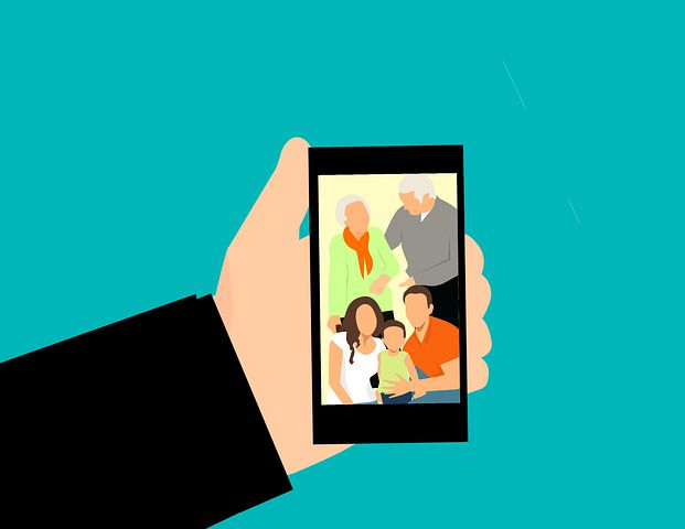 Cartoon image holding a mobile device with family photo