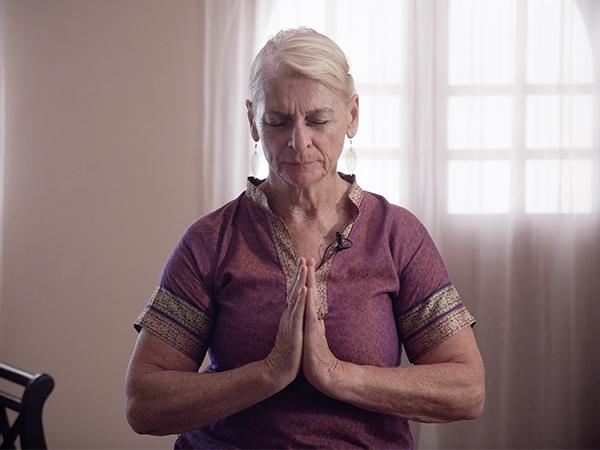 Yoga Teacher teaching online meditation class