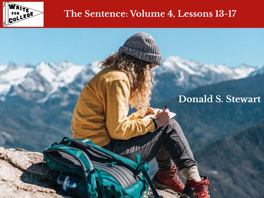 Girl on mountain writing in journal