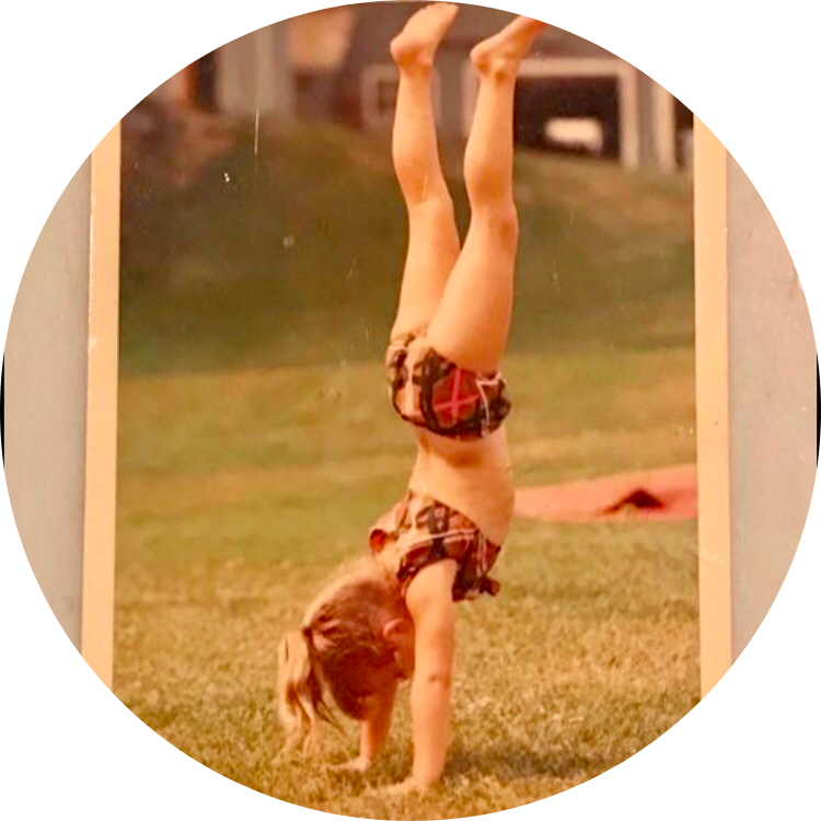 image of young Julie in a handstand