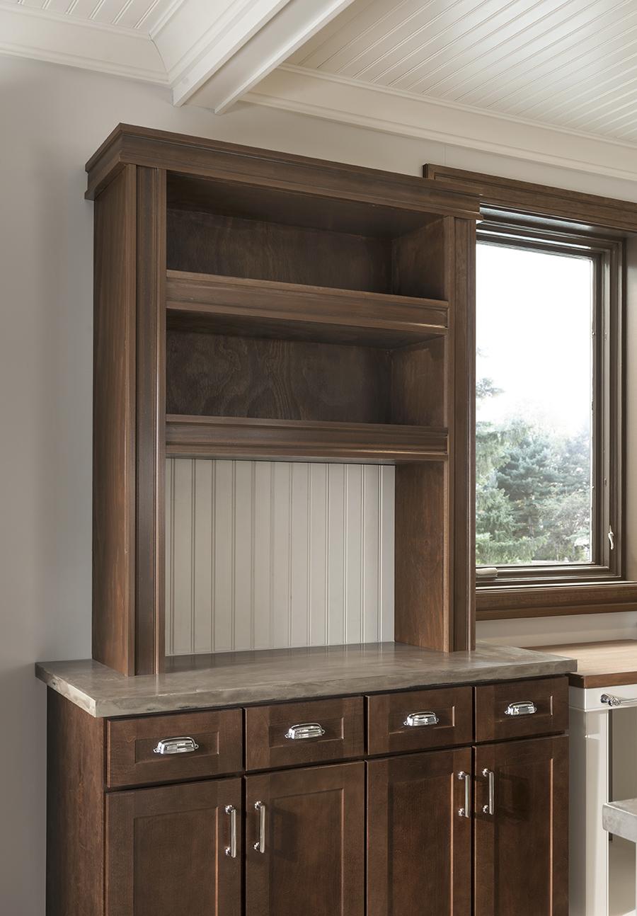 Open shelf area enhanced with mouldings.