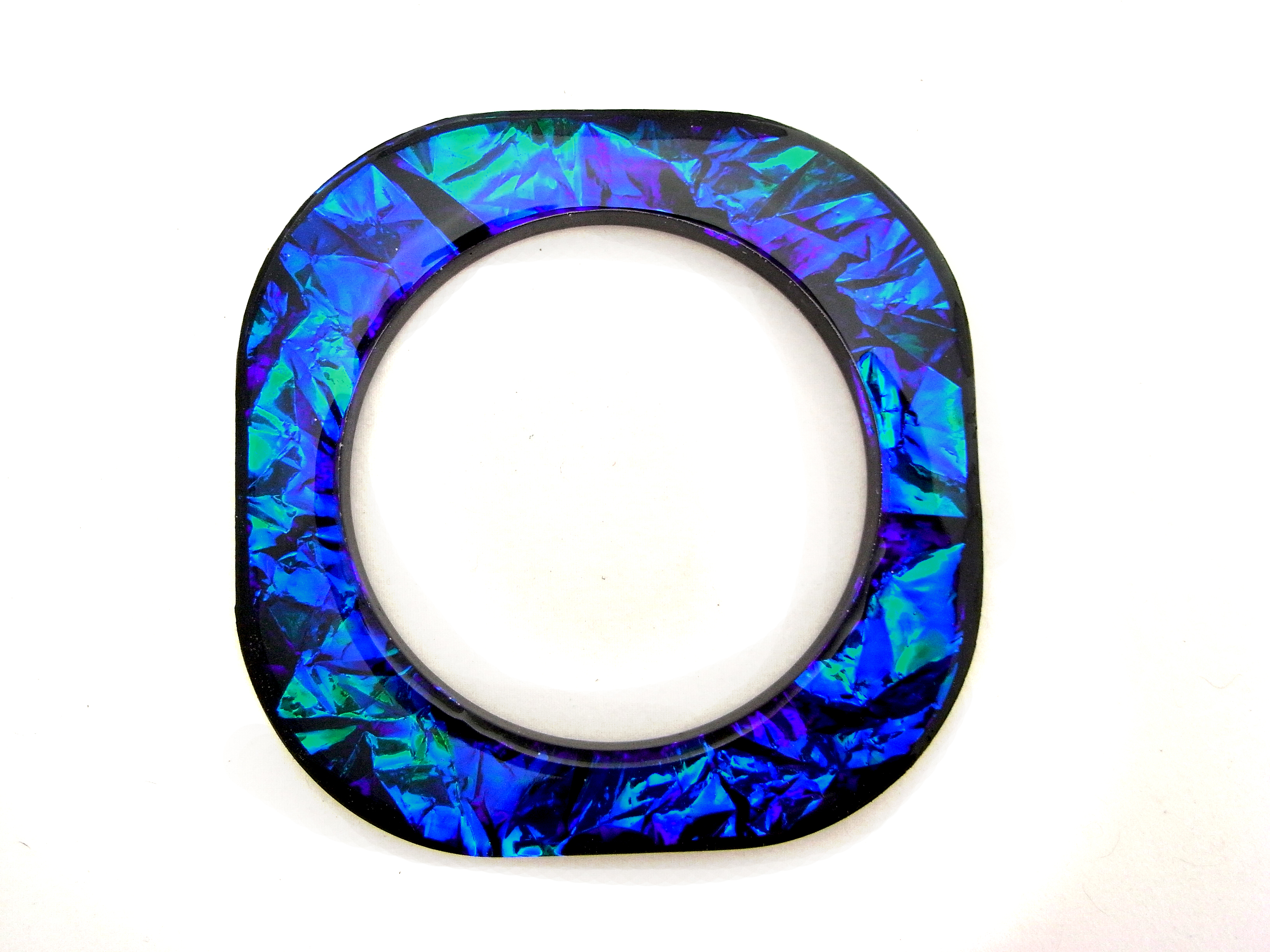 Iridescent square bangle with rounded corners in shimmering shades of blue, green and purple