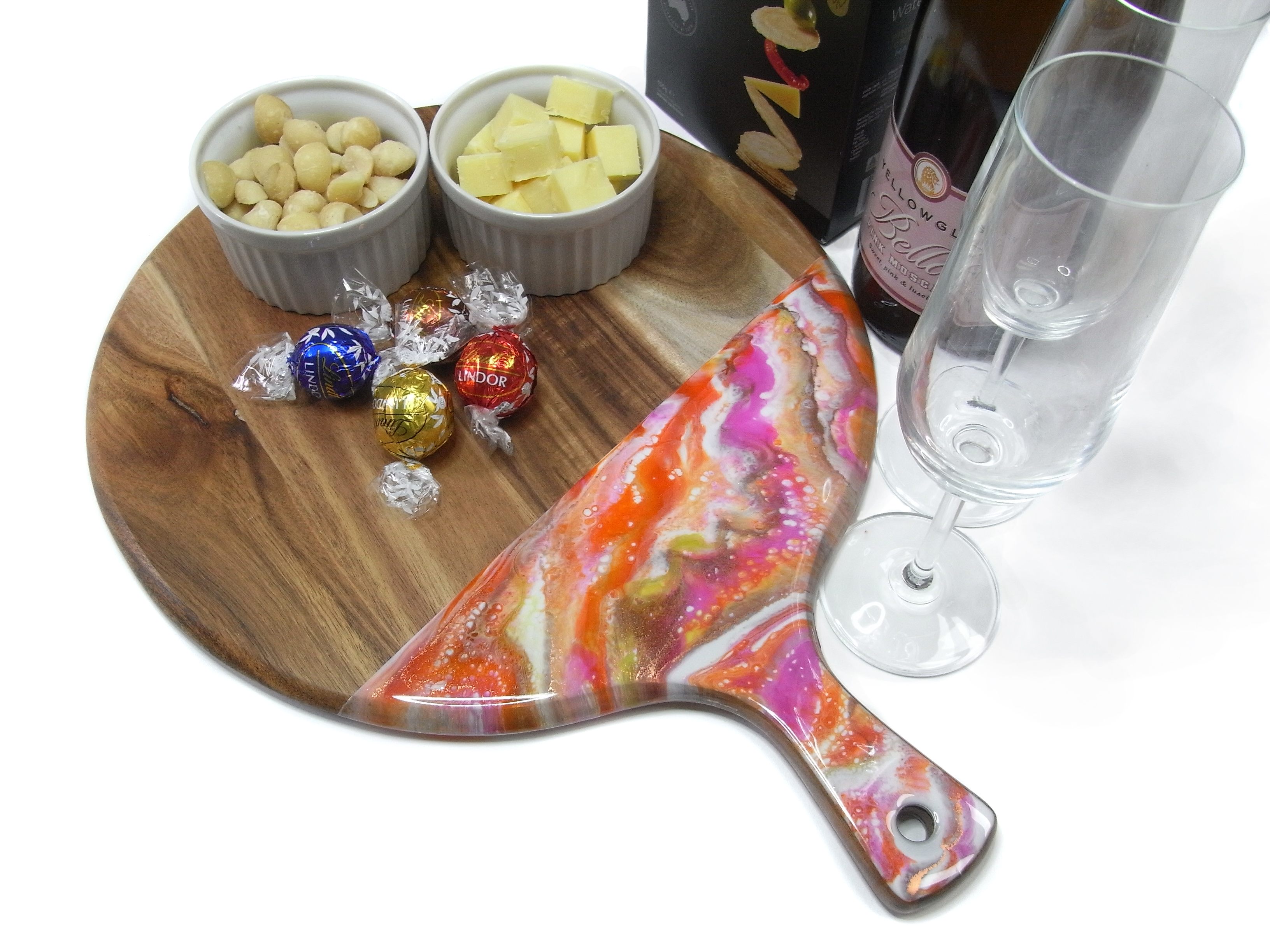 Pink, orange and gold round resin and wood cheeseboard and coasters set