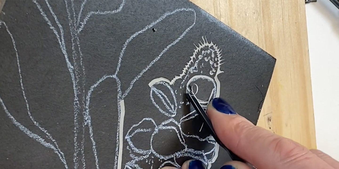 Carving the lino block by Trudy Rice
