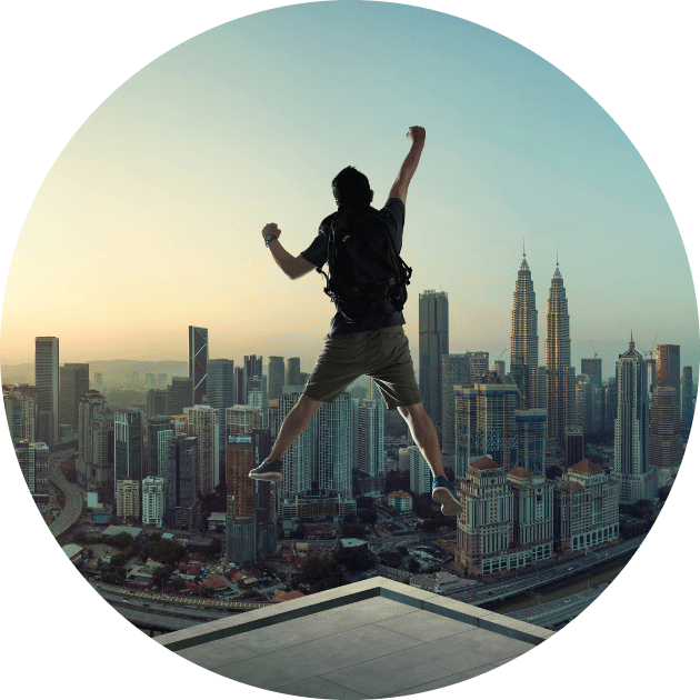 Man jumping with excitement in front of a city skyline