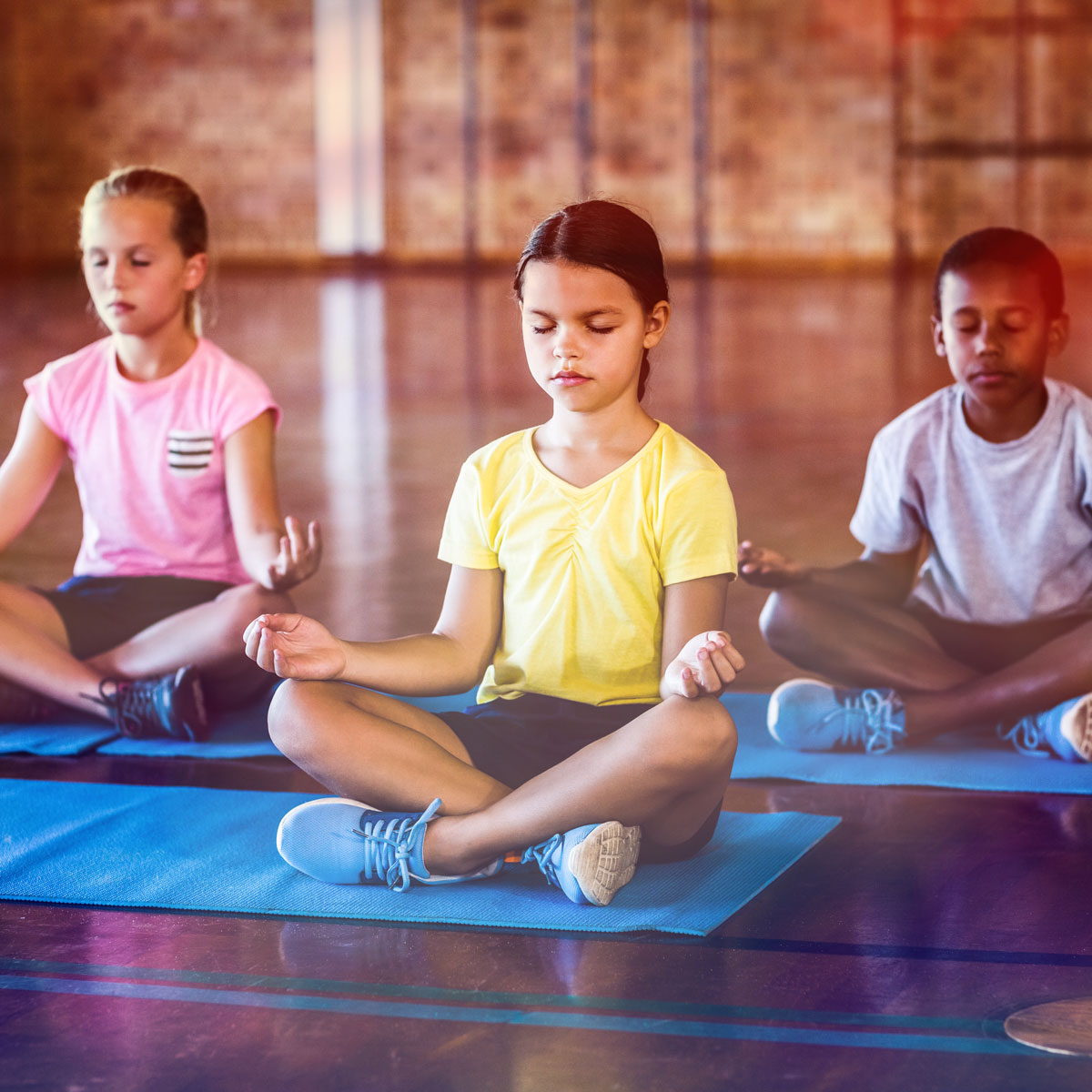 children doing yoga at school