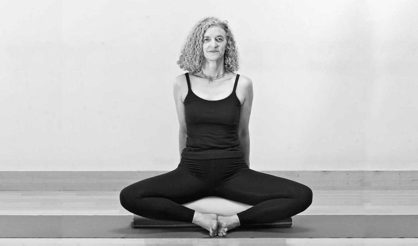 Leslie Howard Yoga - pelvic floor yoga teacher training online - Leslie Howard in Baddha Konasana (bound angle pose)
