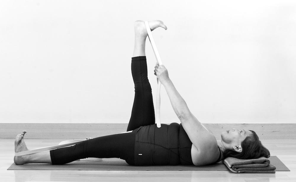 Leslie Howard Yoga - pelvic floor yoga teacher training online - reclining big toe pose with strap (Supta Padangusthasana)