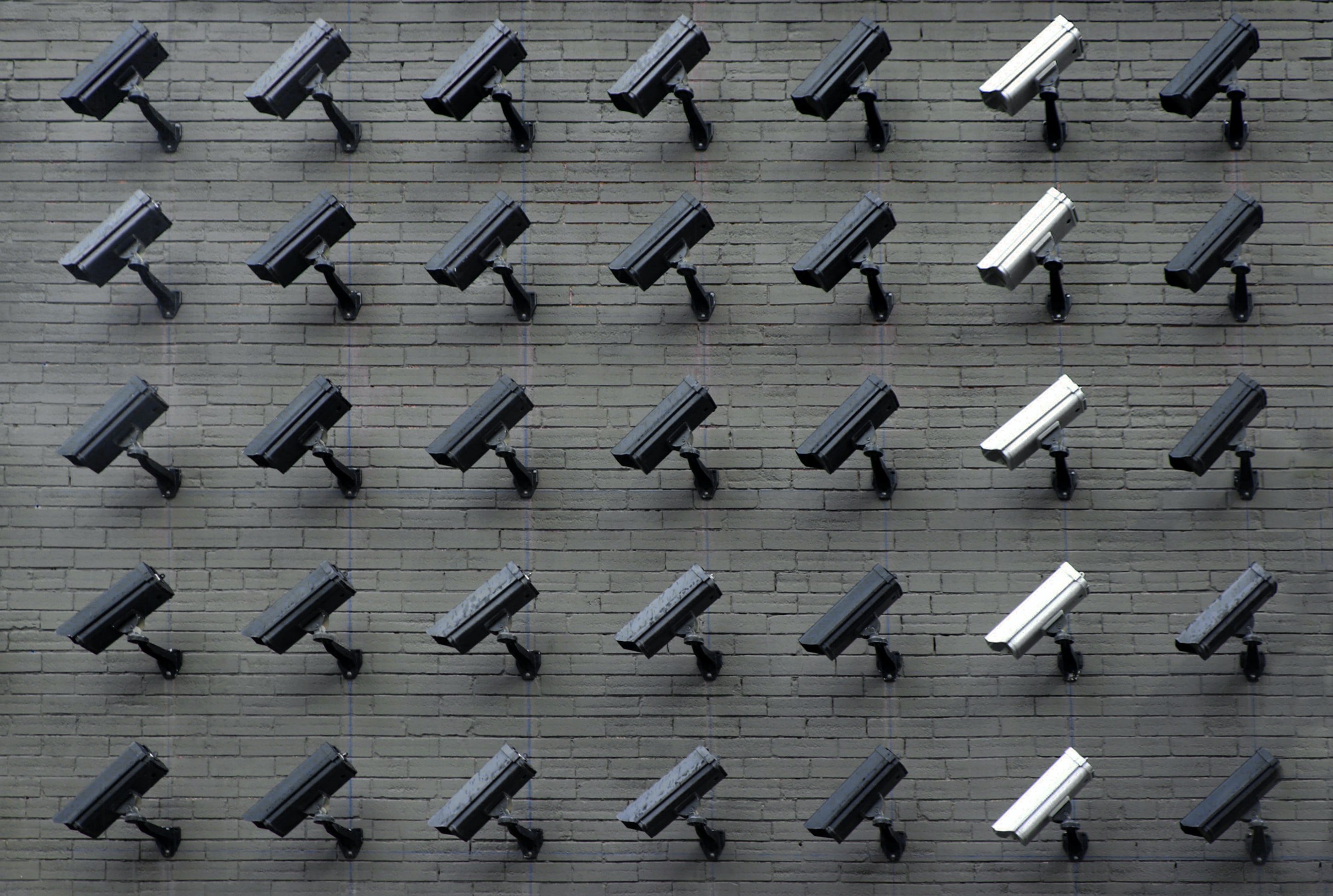 dark and light CCTV camera wall