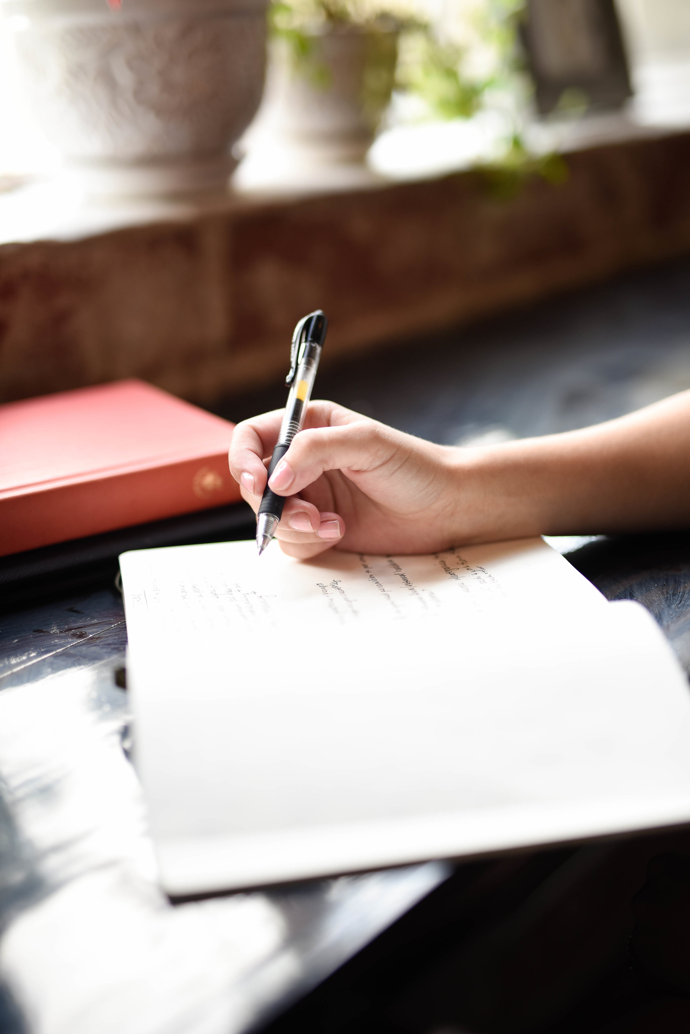 hand writing in a journal