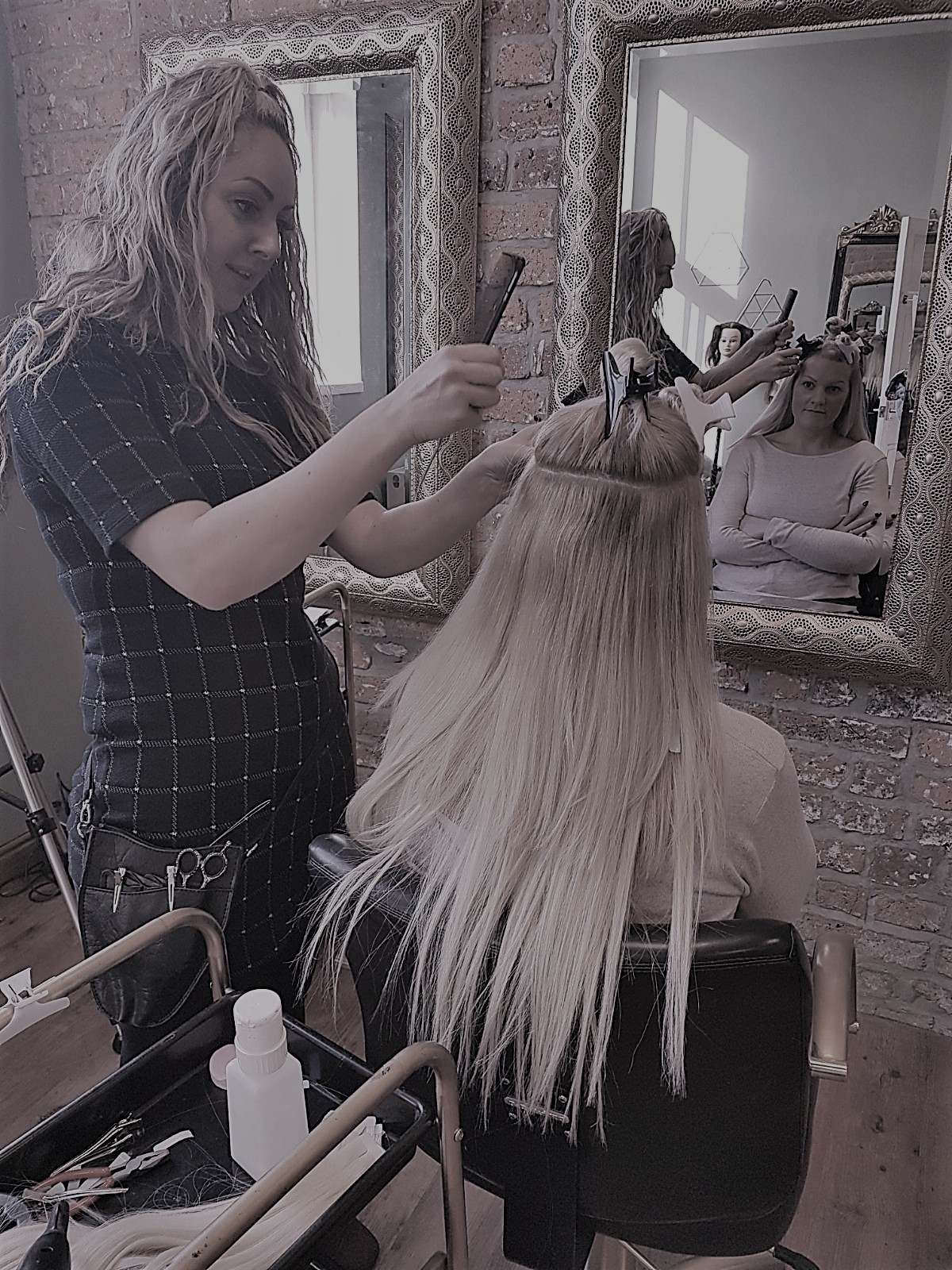 Student applies hair extensions