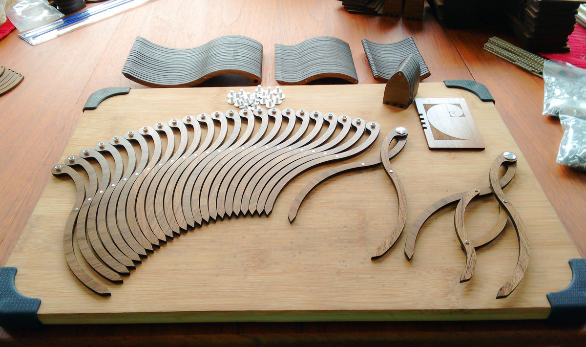 Components of the original proportioner arrayed on a workbench in preparation for final assembly