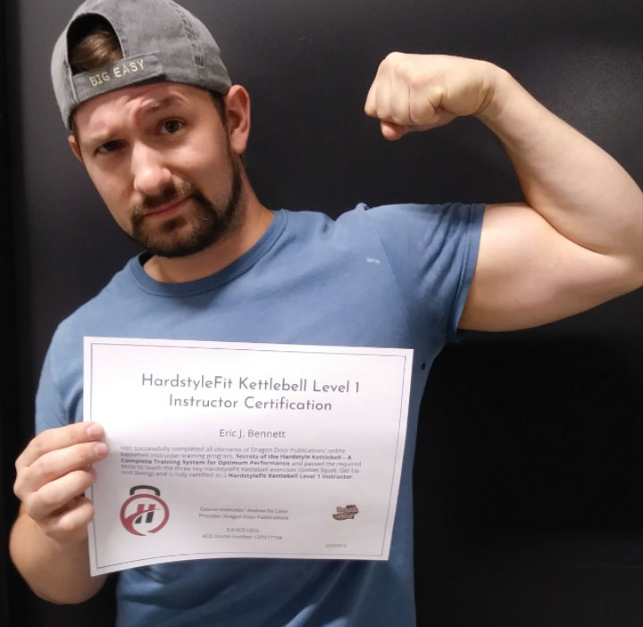 Eric J. Bennett, certified HardstyleFit Instructor poses with certificate