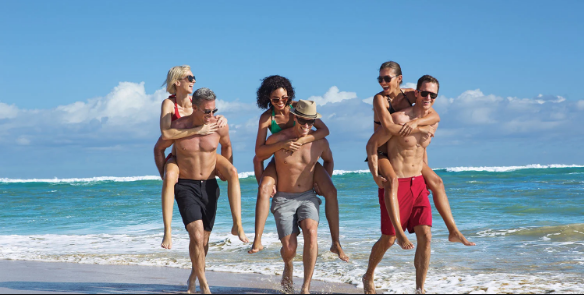 A group of people on a beach  Description automatically generated
