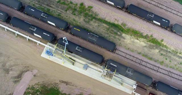 Aerial view of train pulling grain cars on railroad track