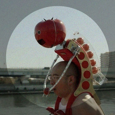 Tomatan, a wearable robot that feeds you tomatoes as you run