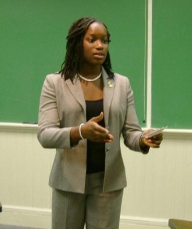 Woman giving a speech in a classroom.