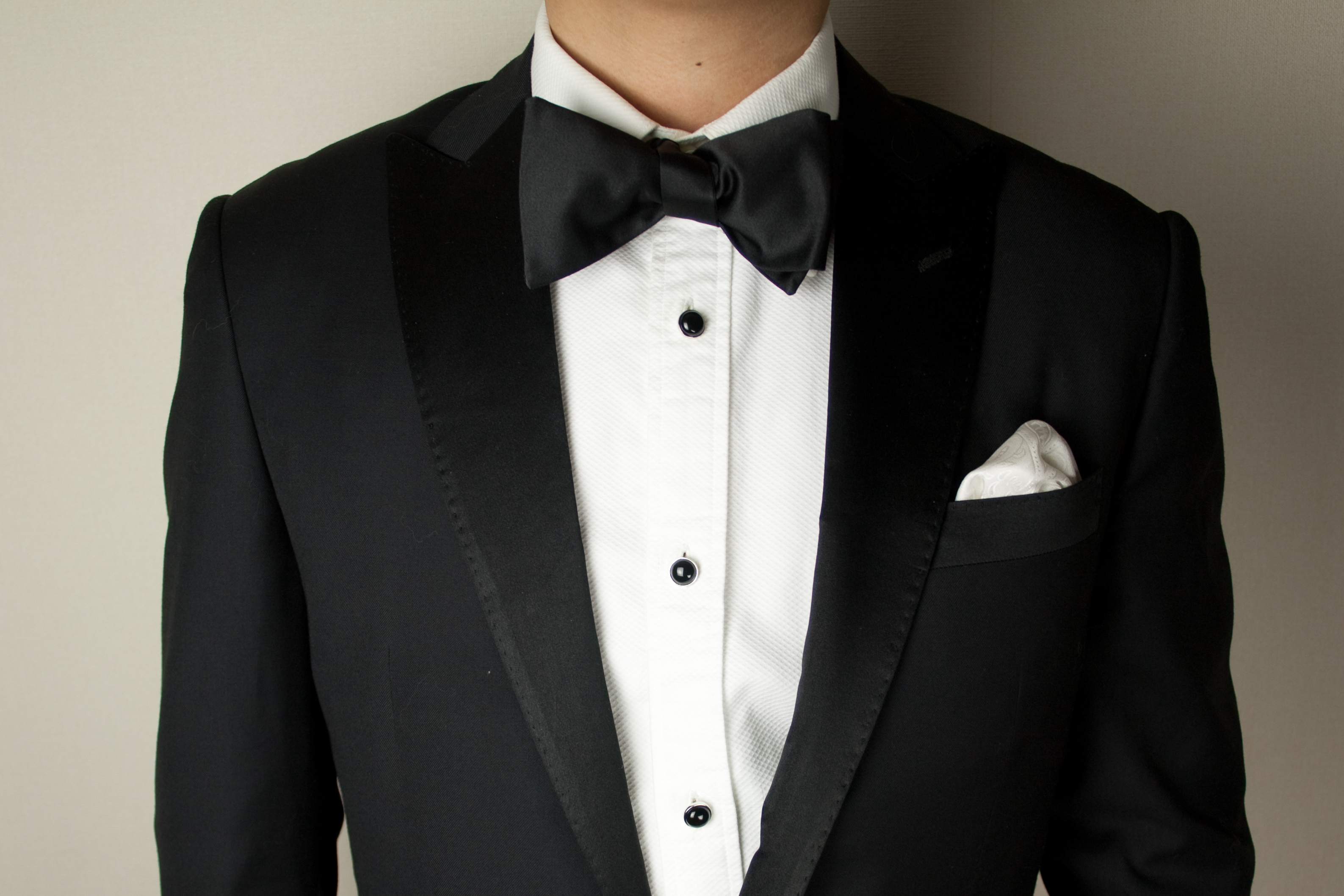 The chest of a man wearing a tuxedo.