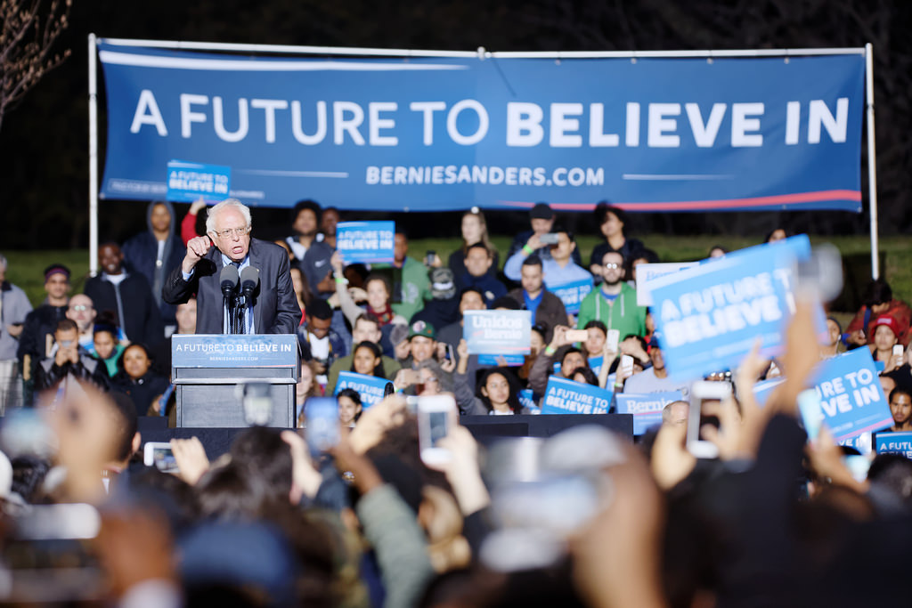 Bernie Sanders campaigning in 2016 in front of his