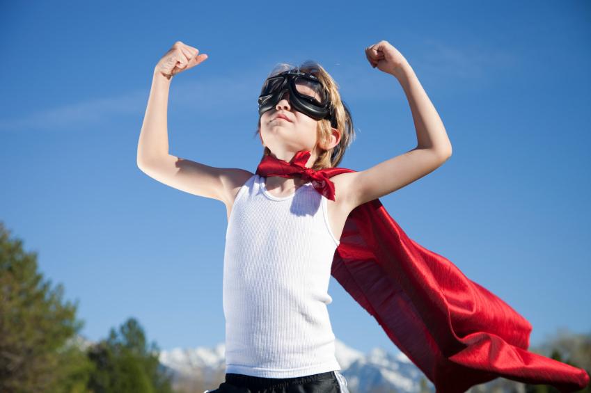 A child in a homemade super hero costume.
