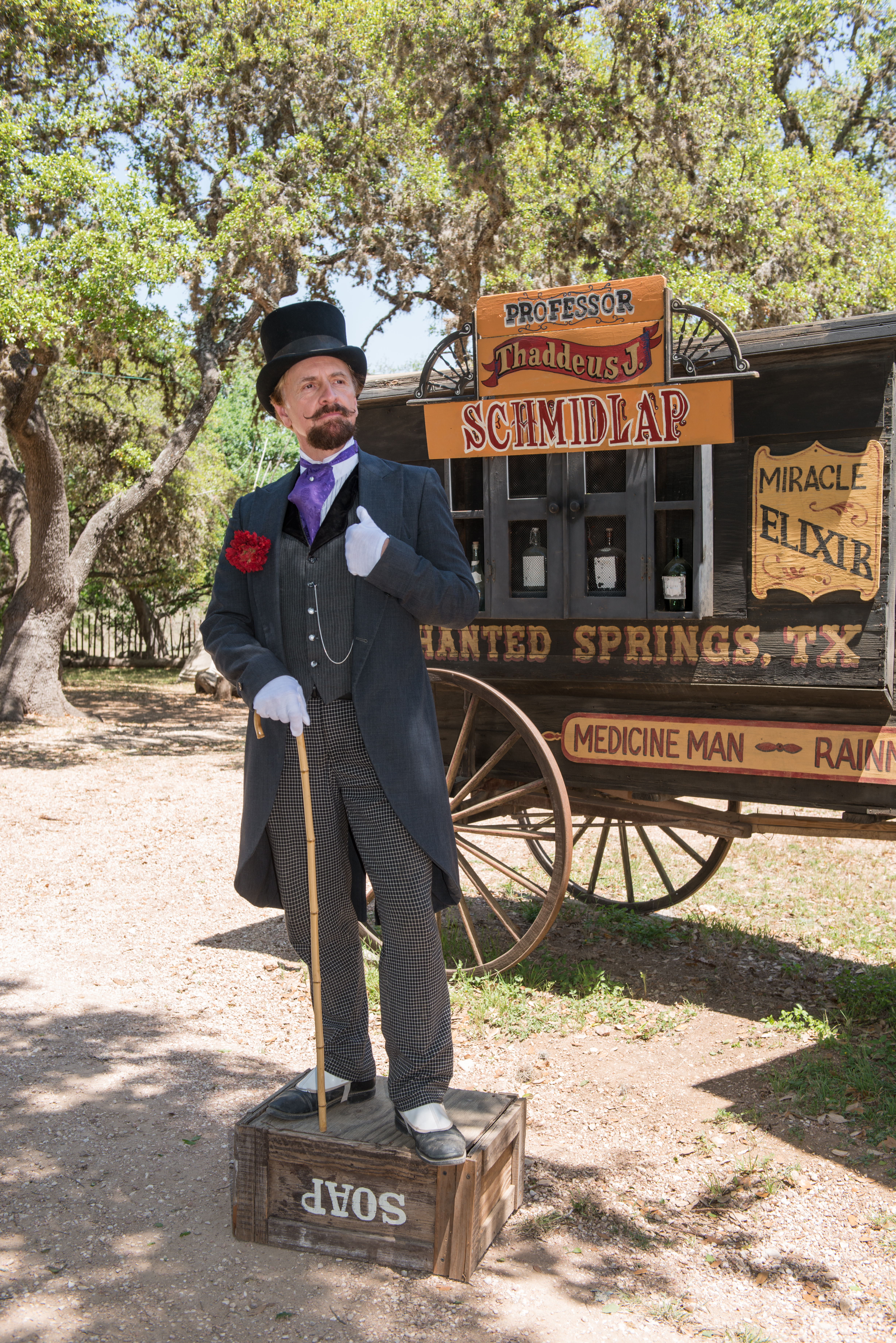 Man dressed up as an old-timey 'snake-oil salesman'.