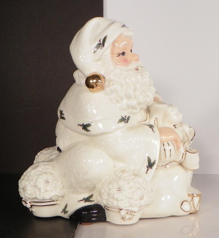 Holly holiday musical ceramic figurine santa claus is