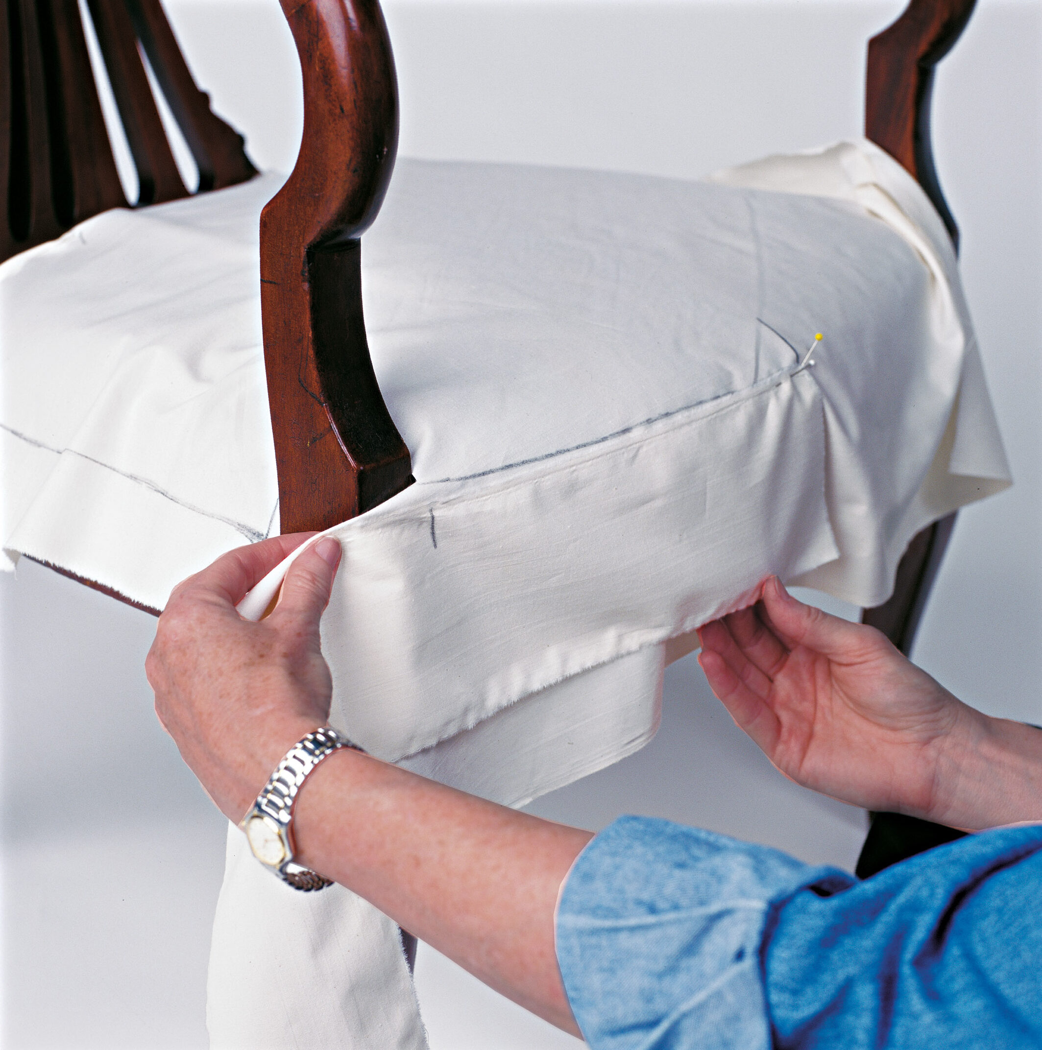 Use strips of muslin to make bands, positioning and pinning them to the seat.