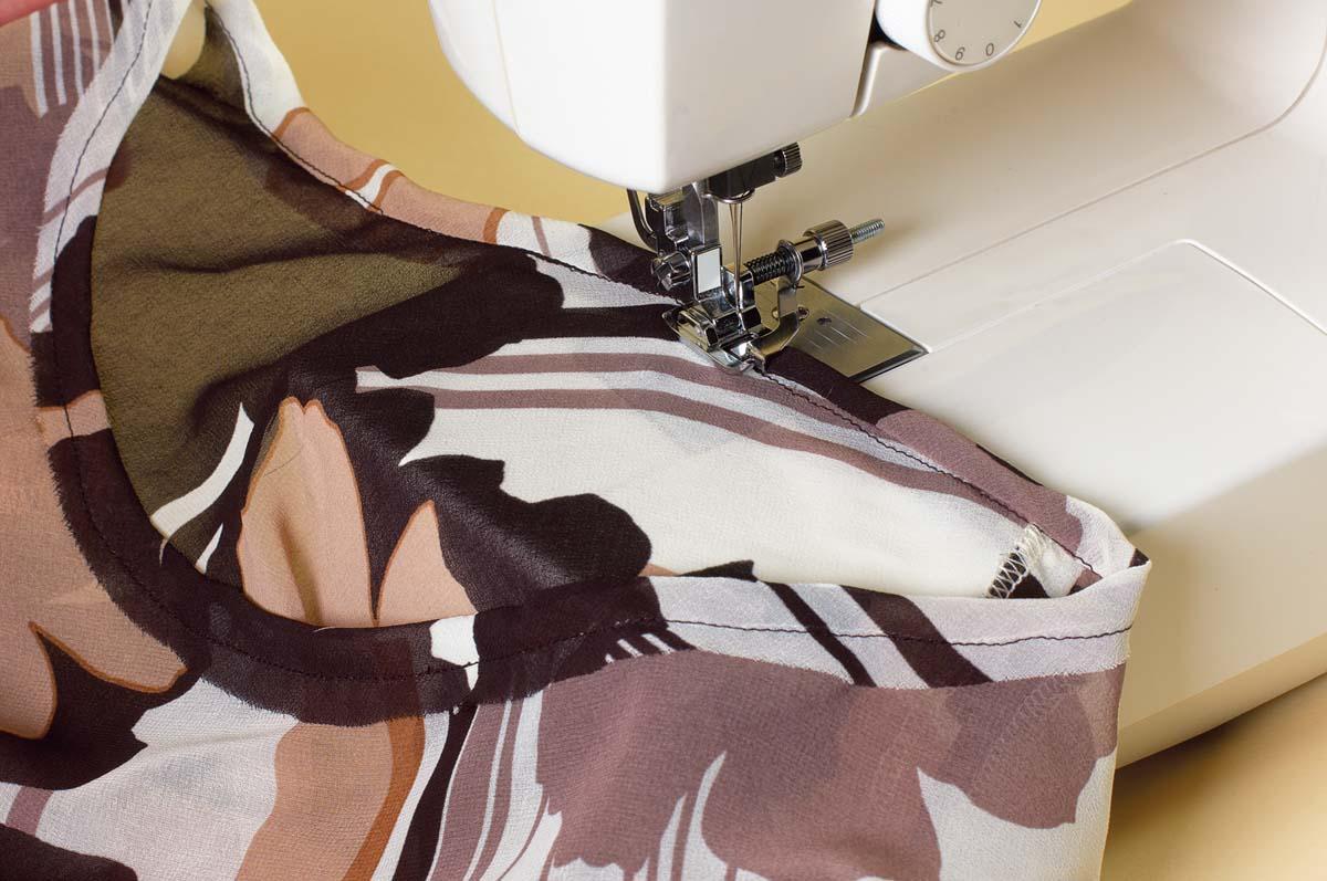 Wrap the trim around the seam allowance and stitch.