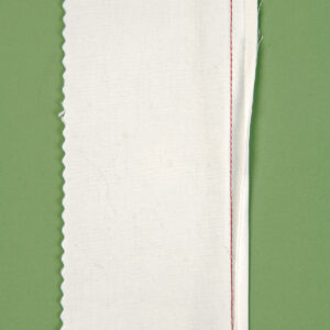 tuck the raw edges under the stitching line to create wrapped flat-fell seams